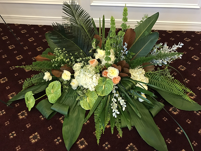 Sago Palm, Sword Fern, Lily Grass, Foxtail, White Mist Boxwood, Oregonia, Variegated & Green Aspidistra, Green Lily Grass, Magnolia, Huckleberry